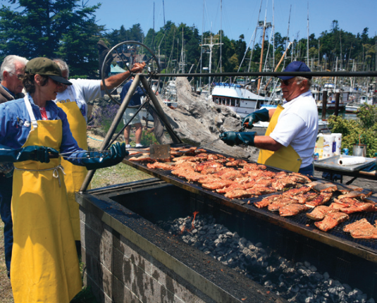 cooking salmon at the worlds largest salmon bbq